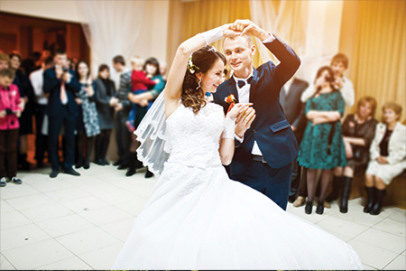 First wedding dance, groom spinning bride while dancing