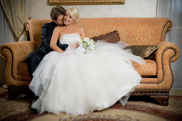 Selecting the perfect wedding dress. Bride in beautiful white wedding dress. WedSafe