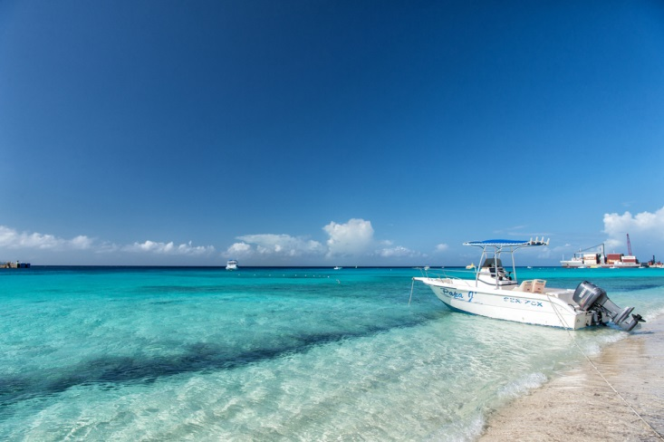 Boat floating by the white sand shores of Turks and Caicos