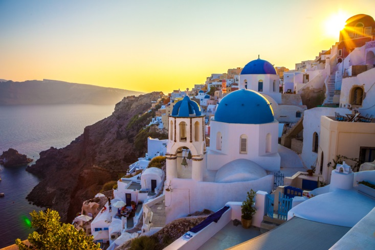 Blue rooves and white buildings of Santorini, Greece at sunset