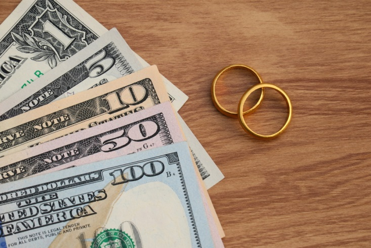 Two golden wedding bands and $166 in cash
